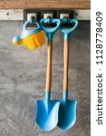 shovels and watering hang on... | Shutterstock . vector #1128778409