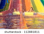 Children on the water slide - stock photo