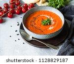 tomato cream soup or puree with ... | Shutterstock . vector #1128829187