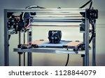3d printer printing a model in...   Shutterstock . vector #1128844079