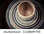 vase from fresh clay turn twirl ... | Shutterstock . vector #1128849755