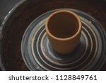 vase from fresh clay turn twirl ... | Shutterstock . vector #1128849761