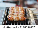 smoked sausage thai street food | Shutterstock . vector #1128854807