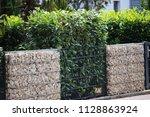 gabion fence wall | Shutterstock . vector #1128863924