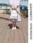 beautiful slim model in a dress ... | Shutterstock . vector #1128864599