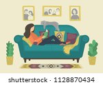 woman reading book on sofa at... | Shutterstock .eps vector #1128870434