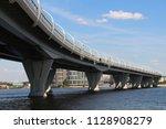 large modern bridge across the... | Shutterstock . vector #1128908279