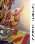 some people holding spain flags ... | Shutterstock . vector #1128912347