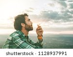 guy smoking a thoughtful... | Shutterstock . vector #1128937991