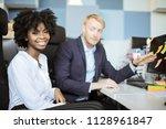 co workers working in the... | Shutterstock . vector #1128961847