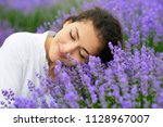 young woman is in the lavender... | Shutterstock . vector #1128967007