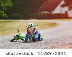 small kid fell from bicycle.... | Shutterstock . vector #1128972341