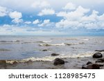 waves of the baltic sea under a ... | Shutterstock . vector #1128985475