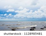 waves of the baltic sea under a ... | Shutterstock . vector #1128985481