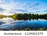 reflections on the water. a... | Shutterstock . vector #1129001579