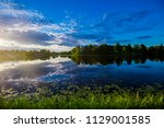reflections on the water. a... | Shutterstock . vector #1129001585