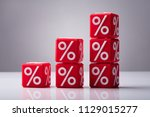 increasing stacked red cubes... | Shutterstock . vector #1129015277