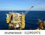 the gas flare is on the oil rig ...   Shutterstock . vector #112901971