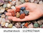 woman holding various tumbled... | Shutterstock . vector #1129027664