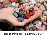 woman holding various tumbled... | Shutterstock . vector #1129027667