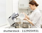 pretty chef cooking cream for... | Shutterstock . vector #1129054931