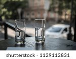 two glasses of water stand on a ... | Shutterstock . vector #1129112831