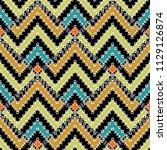 zigzag ethnic tribal vector... | Shutterstock .eps vector #1129126874