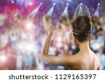 Small photo of Back view Portrait of Miss Pageant Beauty Contest in Evening dress Diamond Crown, Woman fashion make up black hair Face Eyes Heart love, Crown people fanclub cheer celebrate the winner as backgrounds