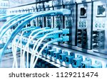 fiber optic cables connected to ... | Shutterstock . vector #1129211474