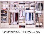 large wardrobe with different... | Shutterstock . vector #1129233707