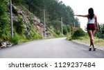 sexy girl stands on hitchhiking ... | Shutterstock . vector #1129237484