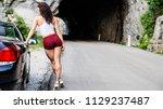 sexy brunette stands sideways... | Shutterstock . vector #1129237487