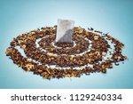 tea bags with scattered dry tea | Shutterstock . vector #1129240334