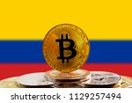 bitcoin btc on stack of... | Shutterstock . vector #1129257494
