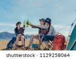 camping group of friends asian... | Shutterstock . vector #1129258064
