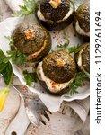 vegetarian stuffed zucchini.... | Shutterstock . vector #1129261694