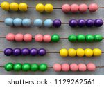 a huge abacus on a wall. | Shutterstock . vector #1129262561