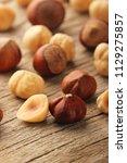 hazelnuts on wooden table | Shutterstock . vector #1129275857