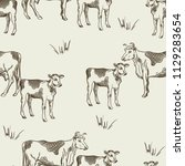 seamless pattern with cows and... | Shutterstock .eps vector #1129283654