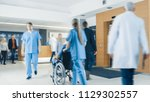hospital lobby. doctors  nurses ... | Shutterstock . vector #1129302557