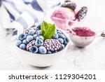close up frozen blueberries and ...   Shutterstock . vector #1129304201