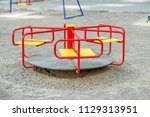 red carousel in the playground. ... | Shutterstock . vector #1129313951