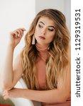 portrait of beautiful young... | Shutterstock . vector #1129319531