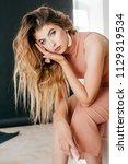 portrait of beautiful young... | Shutterstock . vector #1129319534