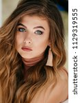 portrait of beautiful young... | Shutterstock . vector #1129319555