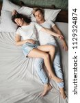 young spouses sleeping carefree ... | Shutterstock . vector #1129324874