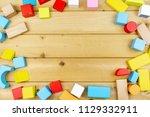 top view of wooden cubes on... | Shutterstock . vector #1129332911