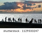 people silhouettes walking at... | Shutterstock . vector #1129333247