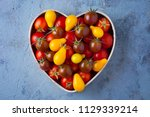 fresh delicious tomatoes in... | Shutterstock . vector #1129339214