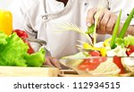chef cooking vegetables at... | Shutterstock . vector #112934515